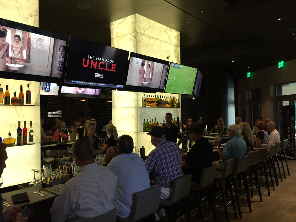 The Woods Jupiter, golfer Tiger Woods' restaurant in Harbourside Place, opened Monday at 4 p.m. with a crowd quickly forming. (Carlos Frías/The Palm Beach Post)