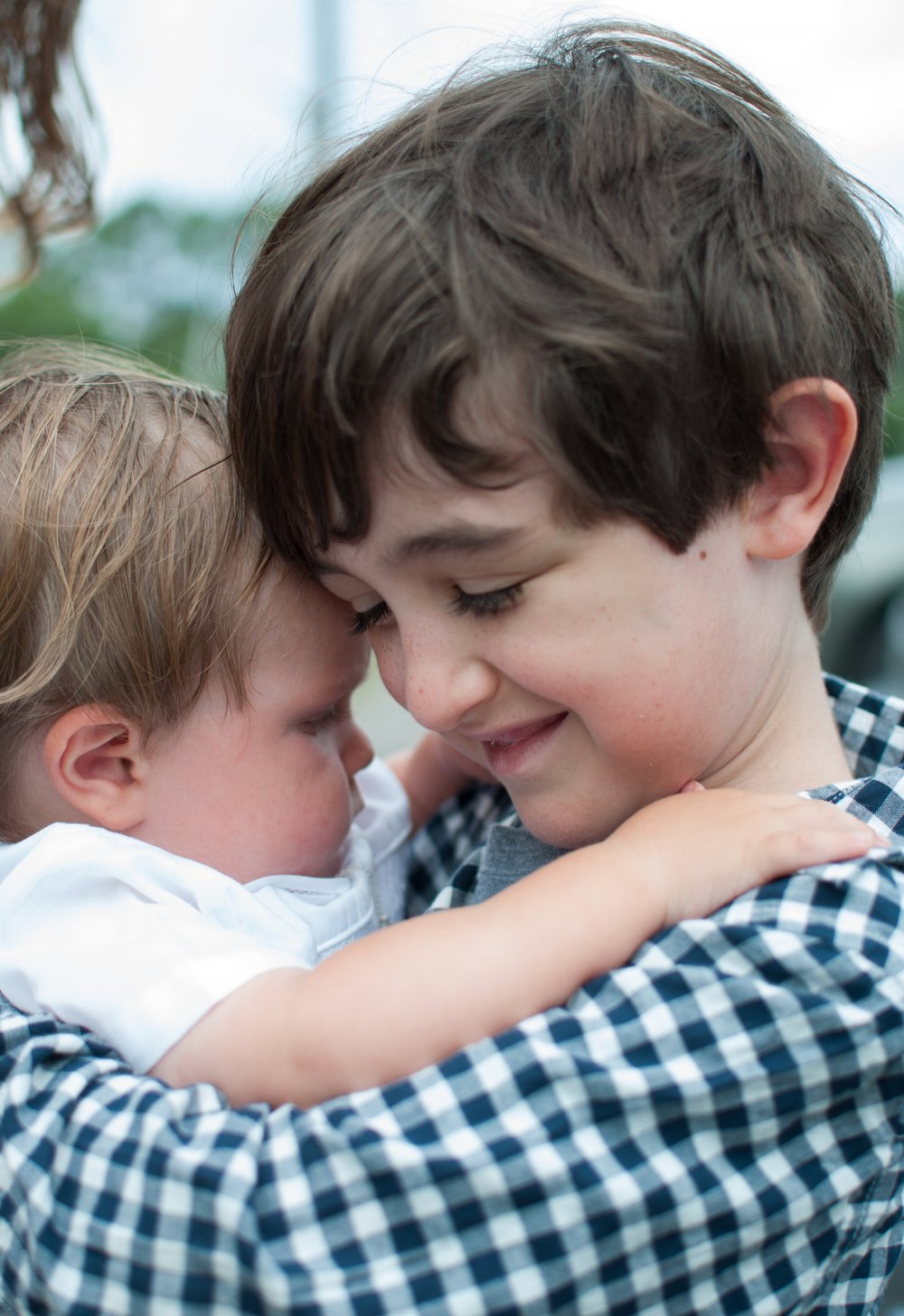 Owen holding Kyle
