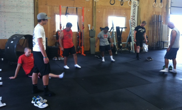 The fellas doing some pre-workout mobility. (That's why they're still smiling).