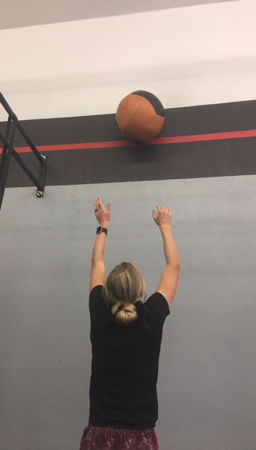 Lauren's breaking in the new red line wall ball target!That's a good rep!