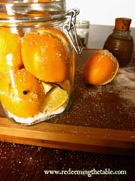 Fill the bottom of your jar about 1/2 inch of salt.  Pack in the generously salted lemons, try and close them up to keep the salt inside.  Then cram them in to keep them close together.