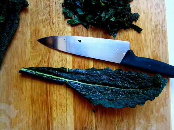Chef knife in the ready with one leaf of kale before we remove the rib.