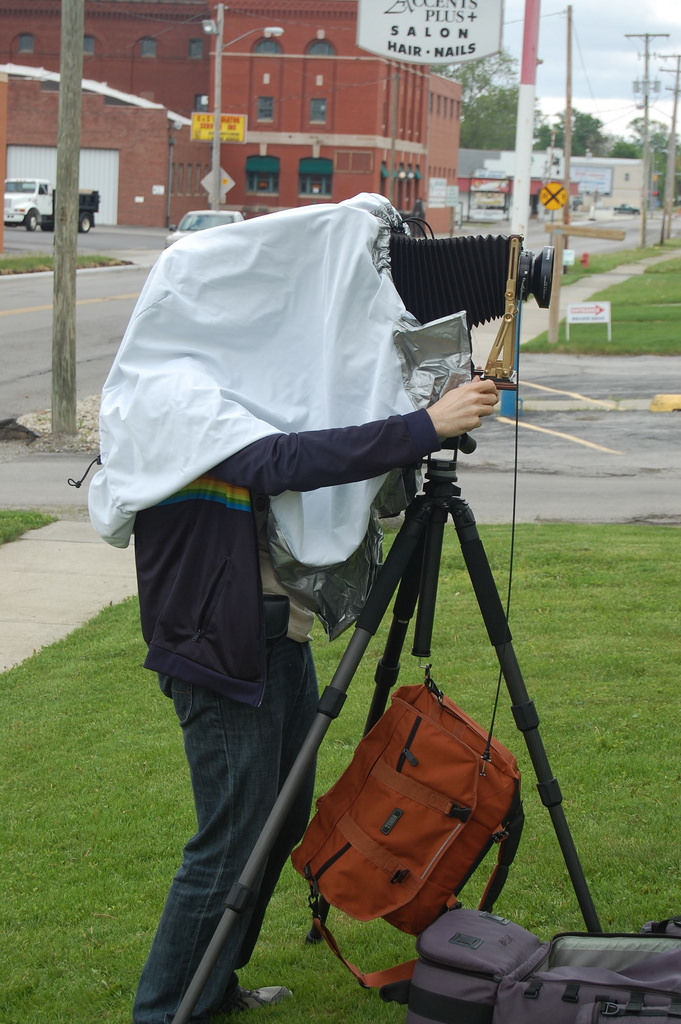 This blog's author with an 8x10 field camera and the Black Jacket 8x10 Hybrid dark cloth. Image by Frank Wilson.