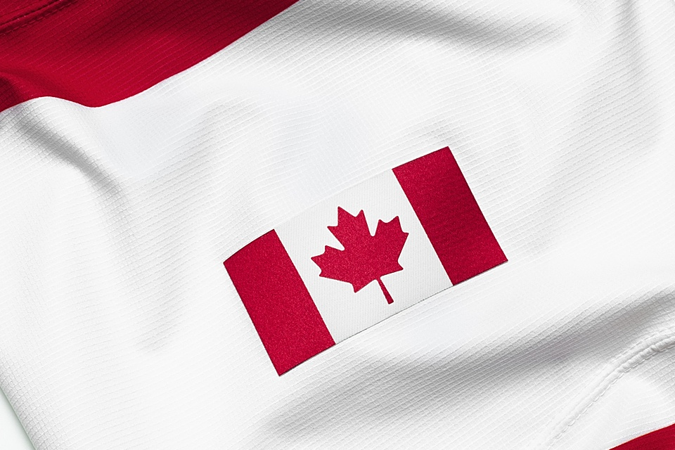 The left sleeve is embellished with the Canadian flag.