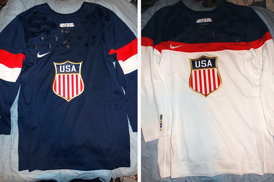"""Notice how the crest is embroidered on the retail jerseys and """"land of the free, home of the brave"""" stays inside the collar, but moves to the back."""