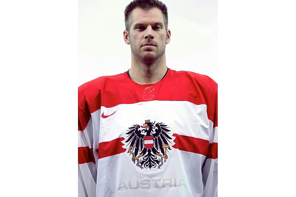 Austria's white jersey features the national coat of arms as well as a near re-creation of the flag (red-white-red).