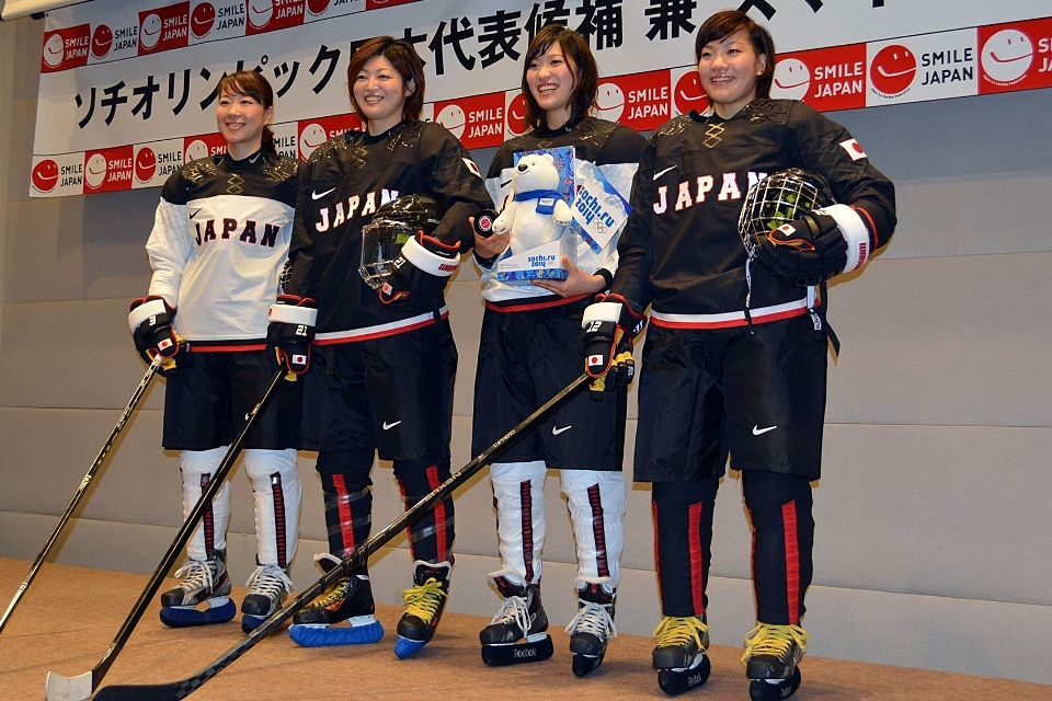 Japan will wear black and white with a hint of red trim. Creative.