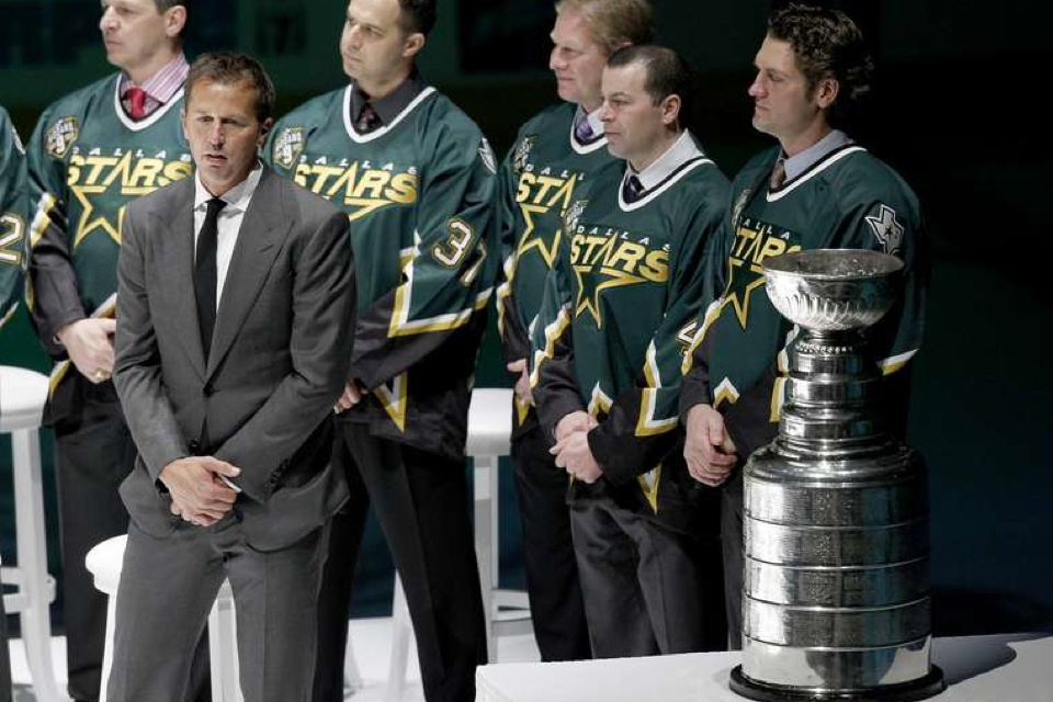 Never seen anyone standing that close to the Stanley Cup look so bored!
