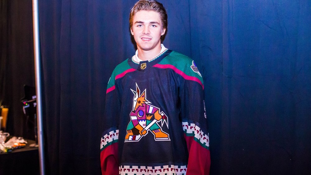 Clayton Keller models the new Coyotes third jersey / via Arizona Coyotes