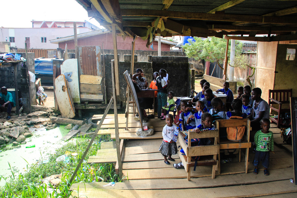 Ago Okota Community School, built on top of sewage. Despite the community's many challenges, 100 of Ago Okota's most vulnerable children receive an education here.