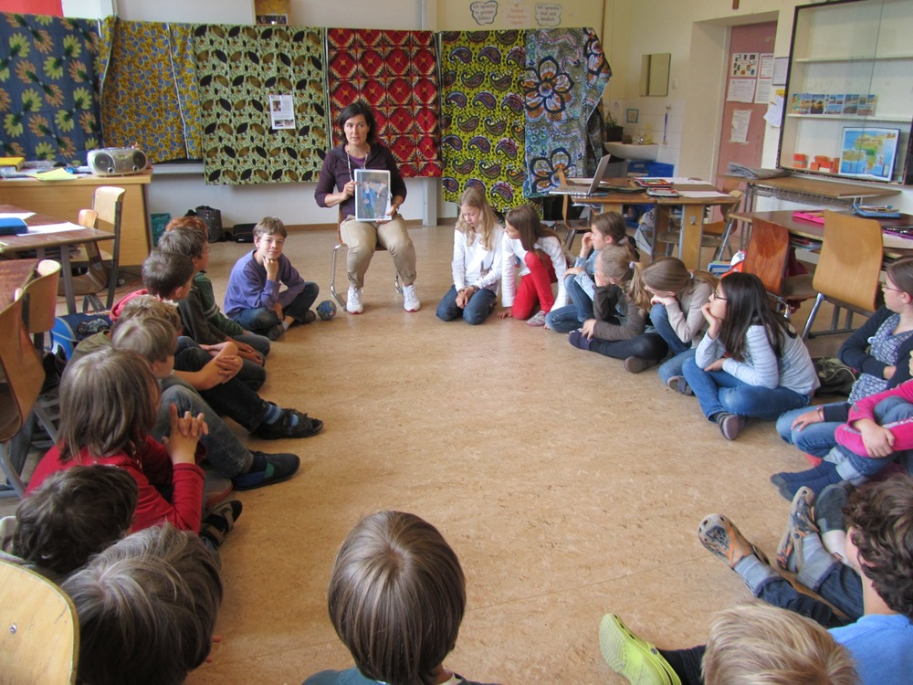 Julia speaking to school children about the life of an African child