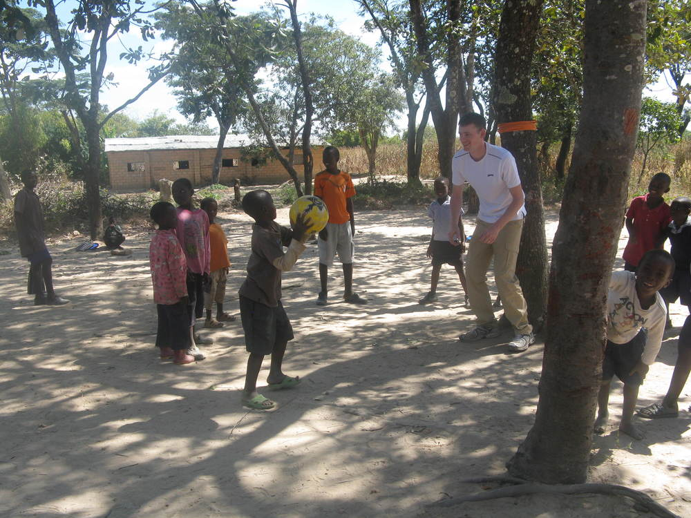 Sam playing with the children of Maposa