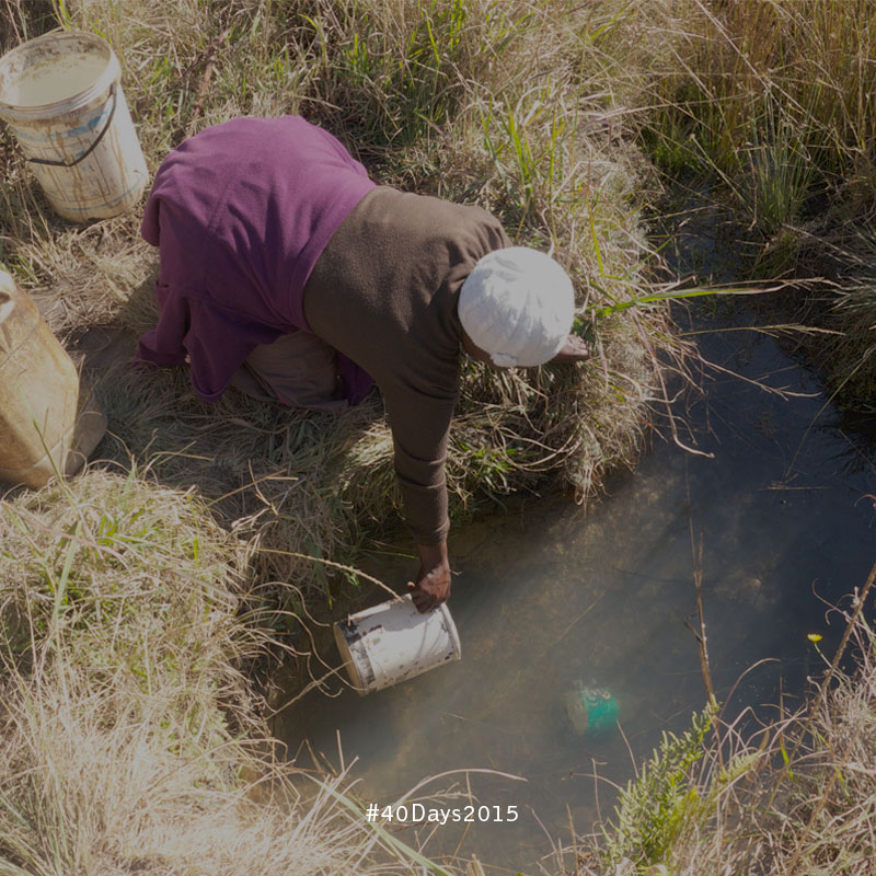 Fetching water in the community of Oshoek, South Africa