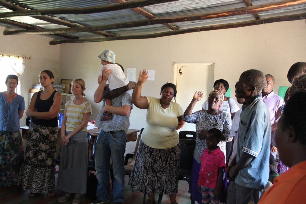 Jen, second from left, joining local and international volunteers in worship in South Africa