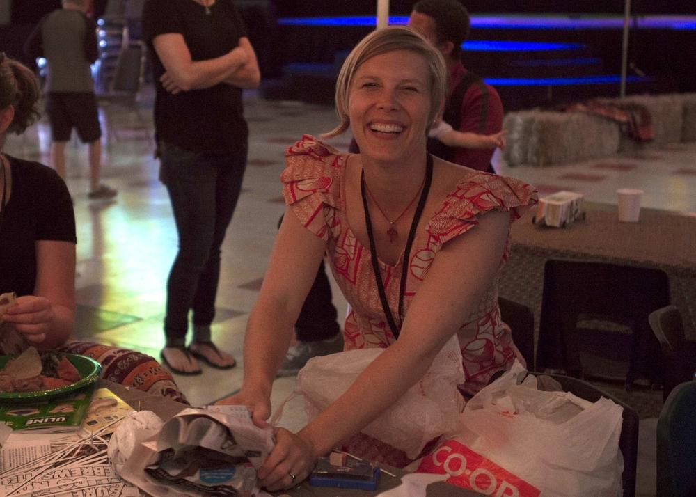 Bree Bone helping children build plastic bag soccer balls.