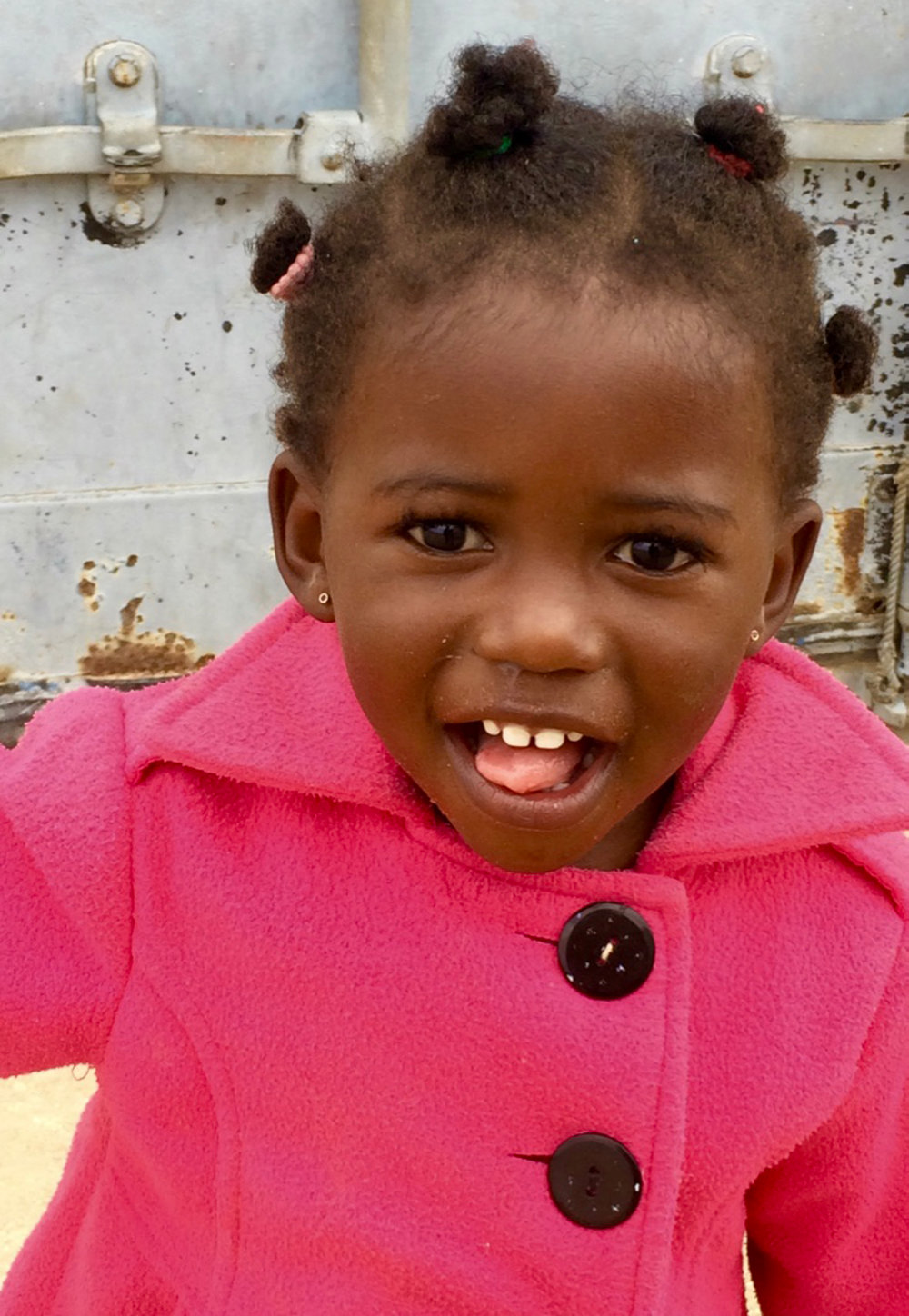 """When I first visited this little girl in Zwelisha, South Africa, in 2015, she was only a few months old. This year, I had the opportunity to go back and visit this sweet girl. I was overjoyed to see her beautiful smile greeting me as I drove up."""
