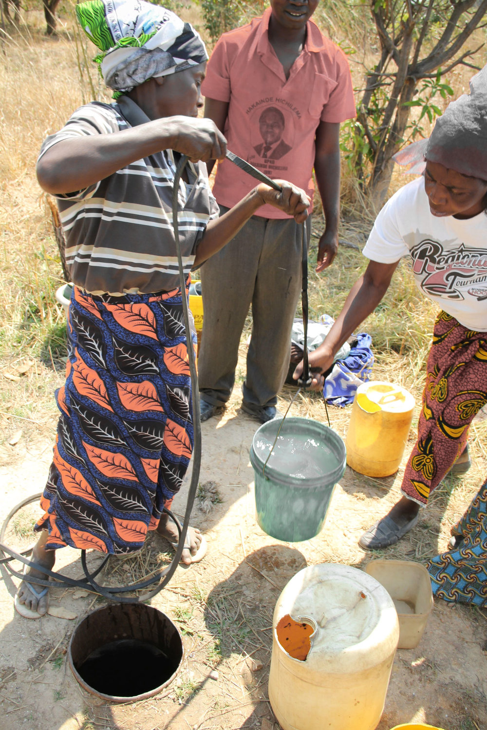 In order to cook for the children and have water for cleaning, the Care Workers have to collect water from the nearby well.