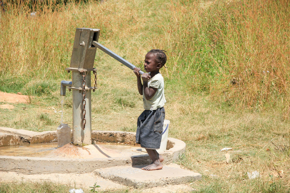 A bore hole that is used to collect water for cooking and drinking.