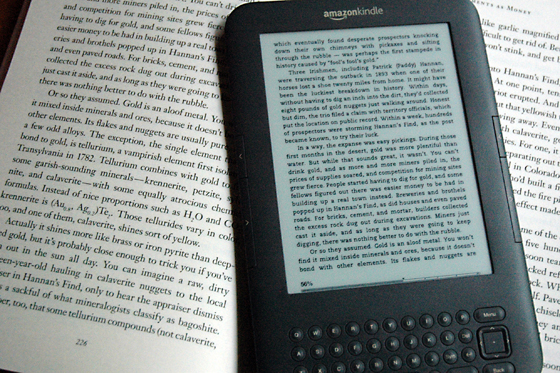 Amazon Kindle with ebook and real book