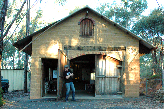 Willo outside his beautiful barn