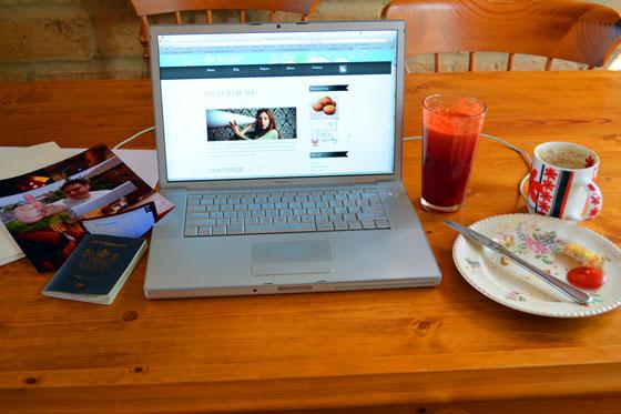 photo of josh, camera, juice, empty coffee cup, dirty breakfast plate, my computer
