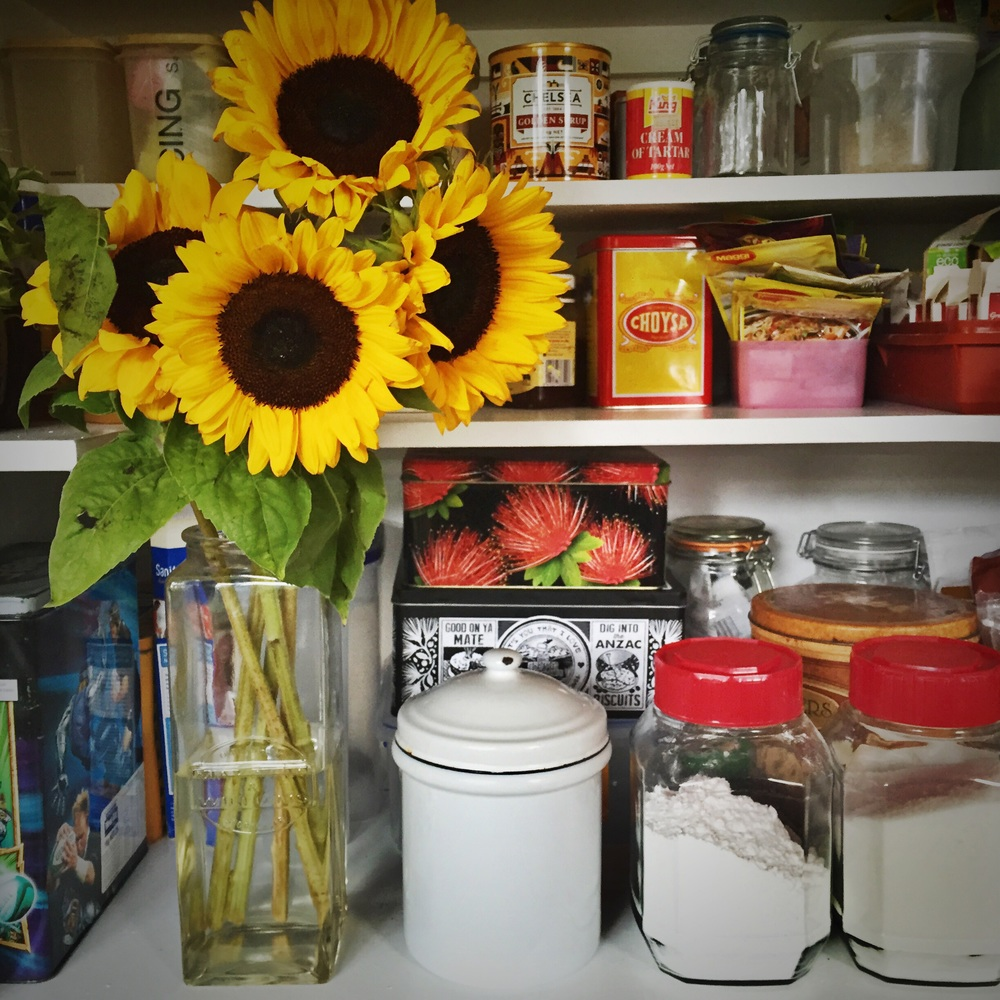 Freshly painted pantry and bright flowers