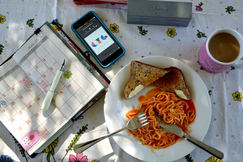 """Listening to """"Call Your Girlfriend"""" podcast and eating spaghetti on toast for breakfast."""