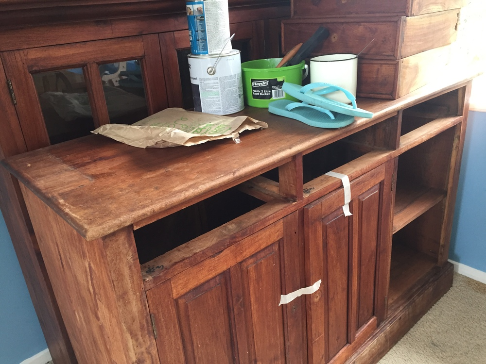The dresser is in two parts - with the glass windowed top (behind) to sit on top of the base (front) unit.