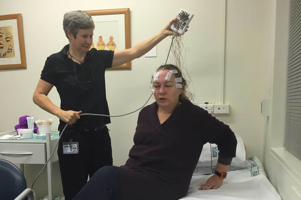 Michelle with an electroencephalogram (EEG) attached to her scalp. This is a test to detect electrical activity of the brain using small, flat metal discs (electrodes) - a test that proved inconclusive.
