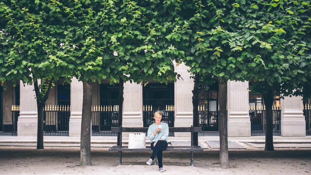 Shopping is hard work. Here's Amy recovering in Jardin du Palais Royal with a coffee from Maison Kitsune Cafe