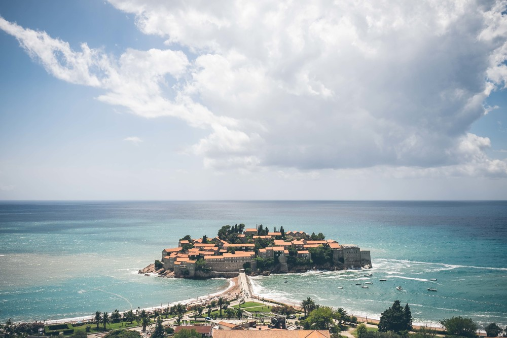 Sveti Stefan resort, Budva; the Adriatic playground of the rich and famous from the 1960s-1980s, now  a 5 star hotel which you can stay in from 1,000 Euros per night