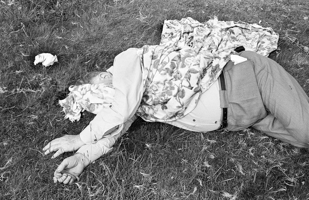 Uncle Les asleep in the sun - Les was my Auntie Rhoda's husband. On Sundays in the summer they would often take me out in the car for a picnic. Les liked to drive to the nearby Brecon Beacons. There we would have sweet tea, ham sandwiches and cream cakes laid out on a cloth. Afterwards Les would invariably fall asleep in the sun. Rhoda would worry about him being burnt and would attempt to cover him with the cloth. It was a miracle she never suffocated him. I always remember an occasion at their home when she once woke him up because he hadn't taken his sleeping tablet.