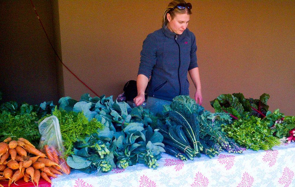 Kristin Kvernland, Youth Garden Manager, displaying some of our fresh garden produce for sale