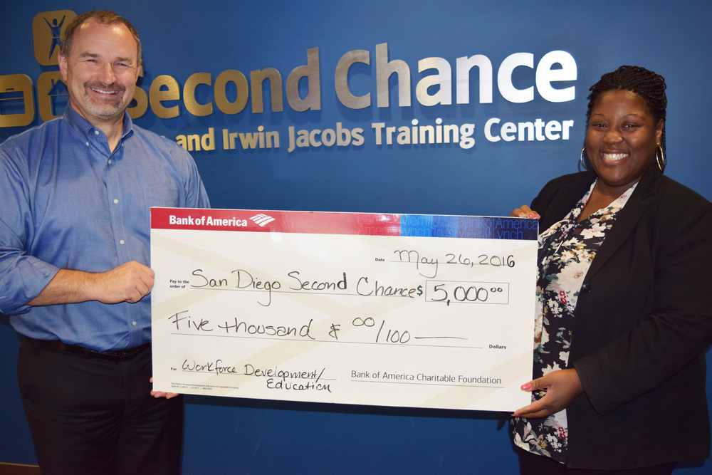 Thanks to Bank of America for supporting our programs and services. In addition to financial support, Bank of America employees volunteer at Second Chance and donate professional clothing. Pictured: Robert Coleman, President & CEO of Second Chance, and Amber Oliver, Financial Center Manager for Bank of America.