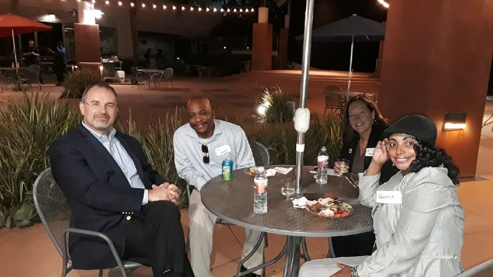 Robert with graduate Breon and others.jpg