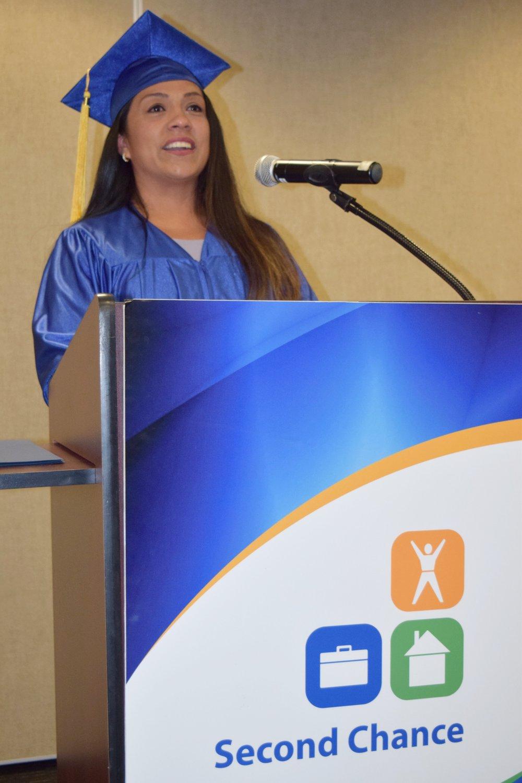 Veronica at graduation podium.JPG