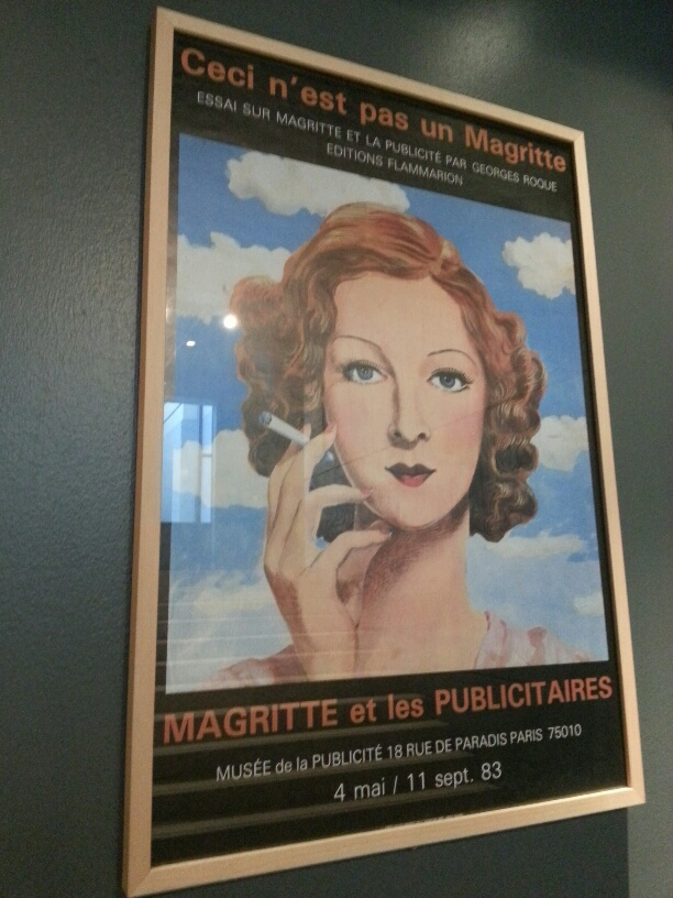 Vintage museum exhibit poster at the Magritte Museum