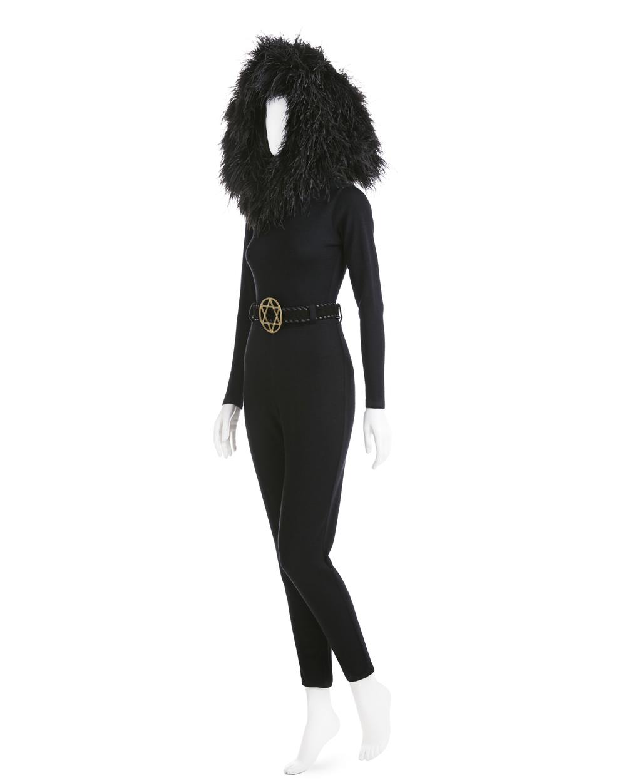 Blackbird, Star of David belt, ostrich-feather hood, stretch wool jersey bodysuit, stretch wool jersey pants, suede and brass belt, Fall 1991. Photograph: Jason Frank Rothenberg.