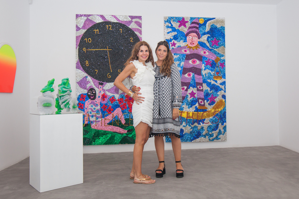 Maria Brito with Marina Vranopoulou at the 'Greek Gotham' exhibit in Mykonos. Image courtesy of Maria Brito.