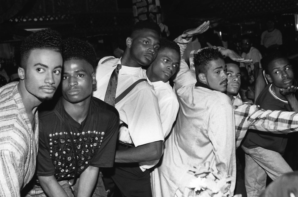 From left, Whitney Elite, Ira Ebony, Stewart and Chris LaBeija, Ian and Jamal Adonis, Ronald Revlon, House of Jourdan Ball, New Jersey, photo by Chantal Regnault, 1989. Photo © Chantal Regnault