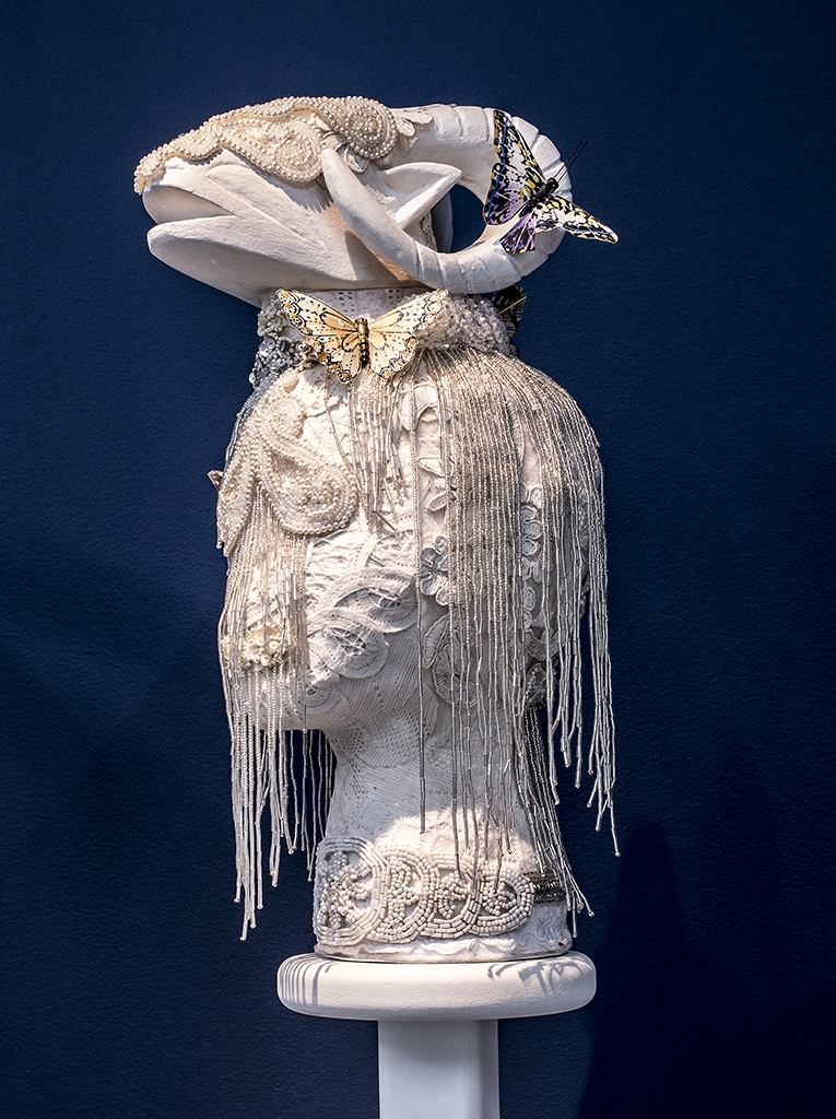 Saya Woolfalk, White Shed (Ram), 2016, Mixed media, Sculpture: 17 x 10 x 6-1/2 inches, Stand: 48 x 12 x 12 inches. Copyright Saya Woolfalk, courtesy Leslie Tonkonow Artworks + Projects, New York