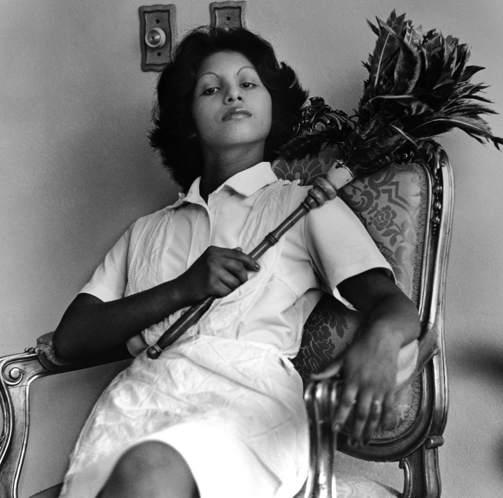 Sandra Eleta (born Panama, 1942). Edita (la del plumero), Panamá (Edita [the one with the feather duster], Panama), 1977, from the series La servidumbre (Servitude), 1978–79. Black-and-white photograph, 19 × 19 in. (48.3 × 48.3 cm). Courtesy of Galería Arteconsult S.A., Panama. © Sandra Eleta