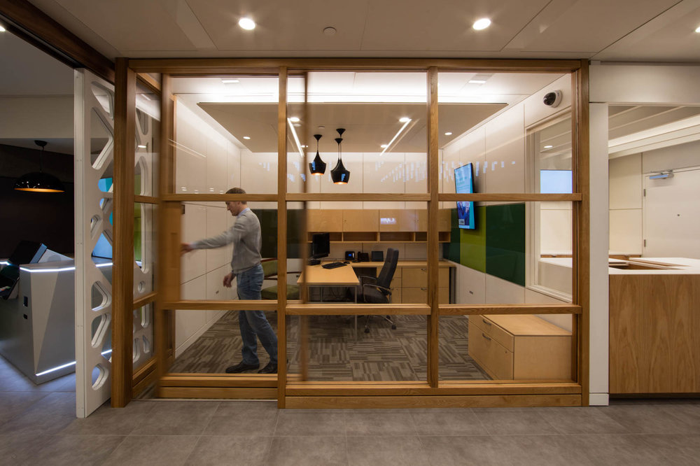 Modern interior with sliding glass wall in office