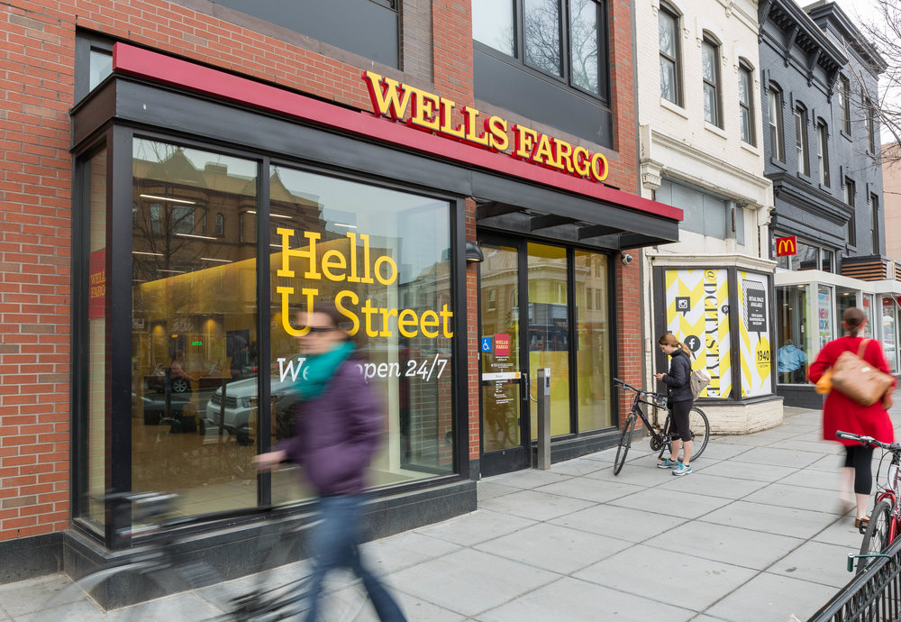 Wells Fargo bank exterior in city with pedestrians