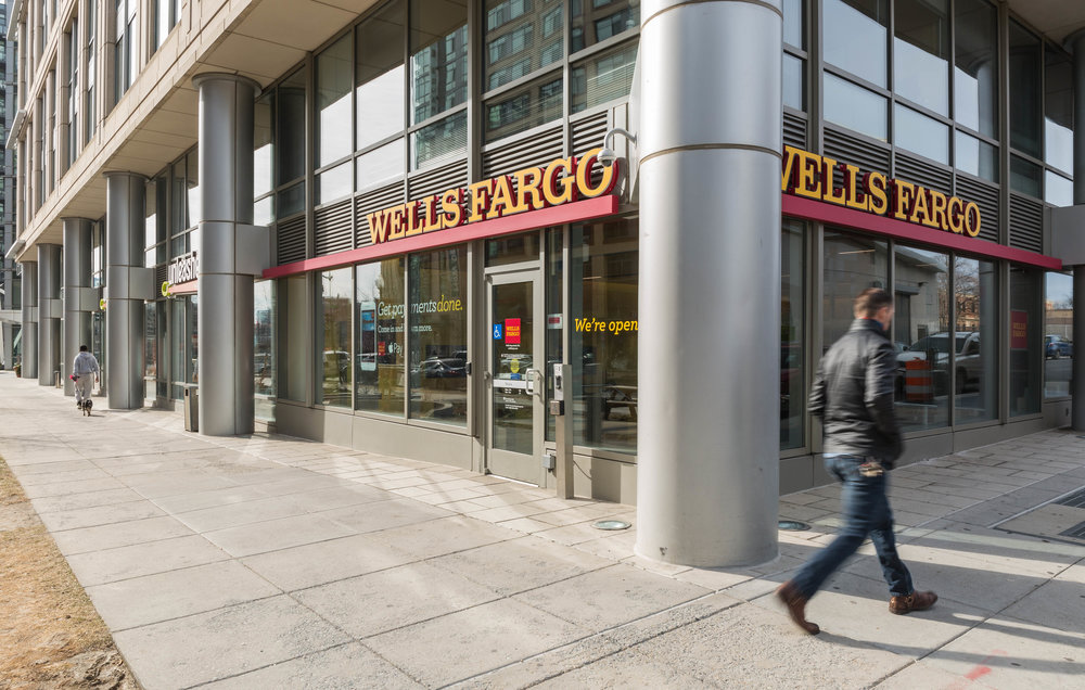 Wells Fargo bank exterior in city with pedestrians