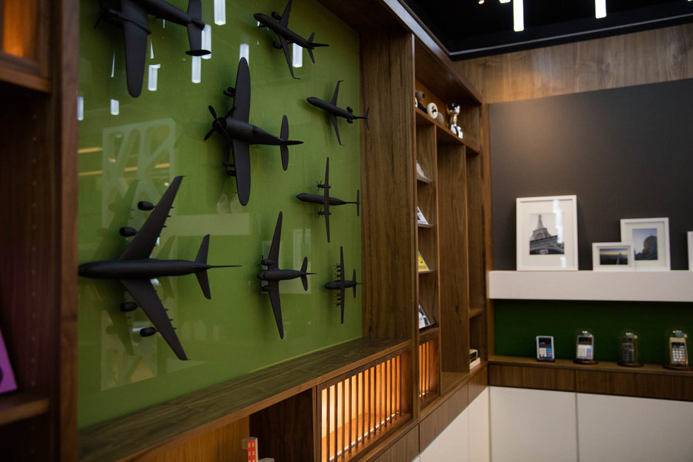 Vintage airplanes in case in office with bookshelf