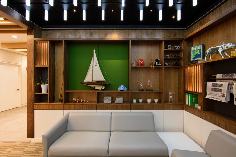 Office with bookshelf, sailboat and couch