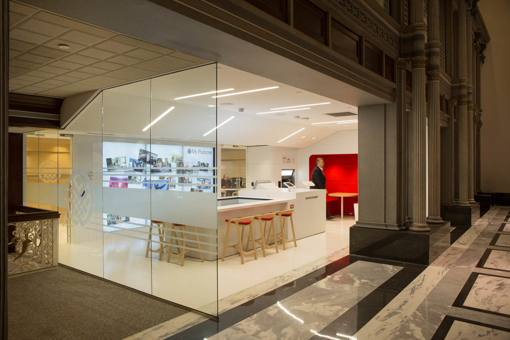 Bright modern bank with glass wall
