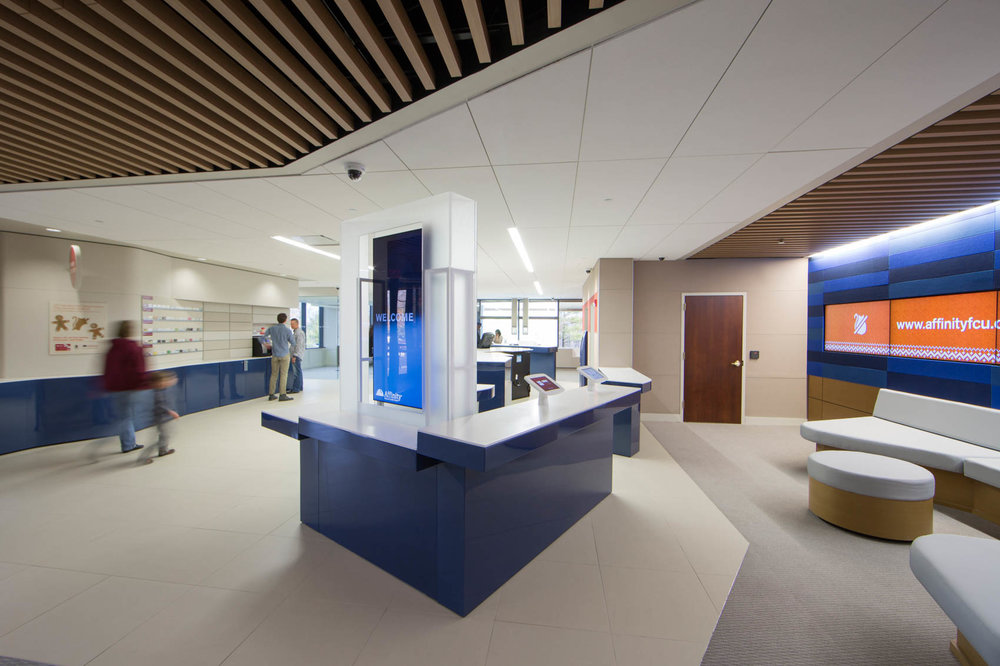 Modern bank blue interior with customers