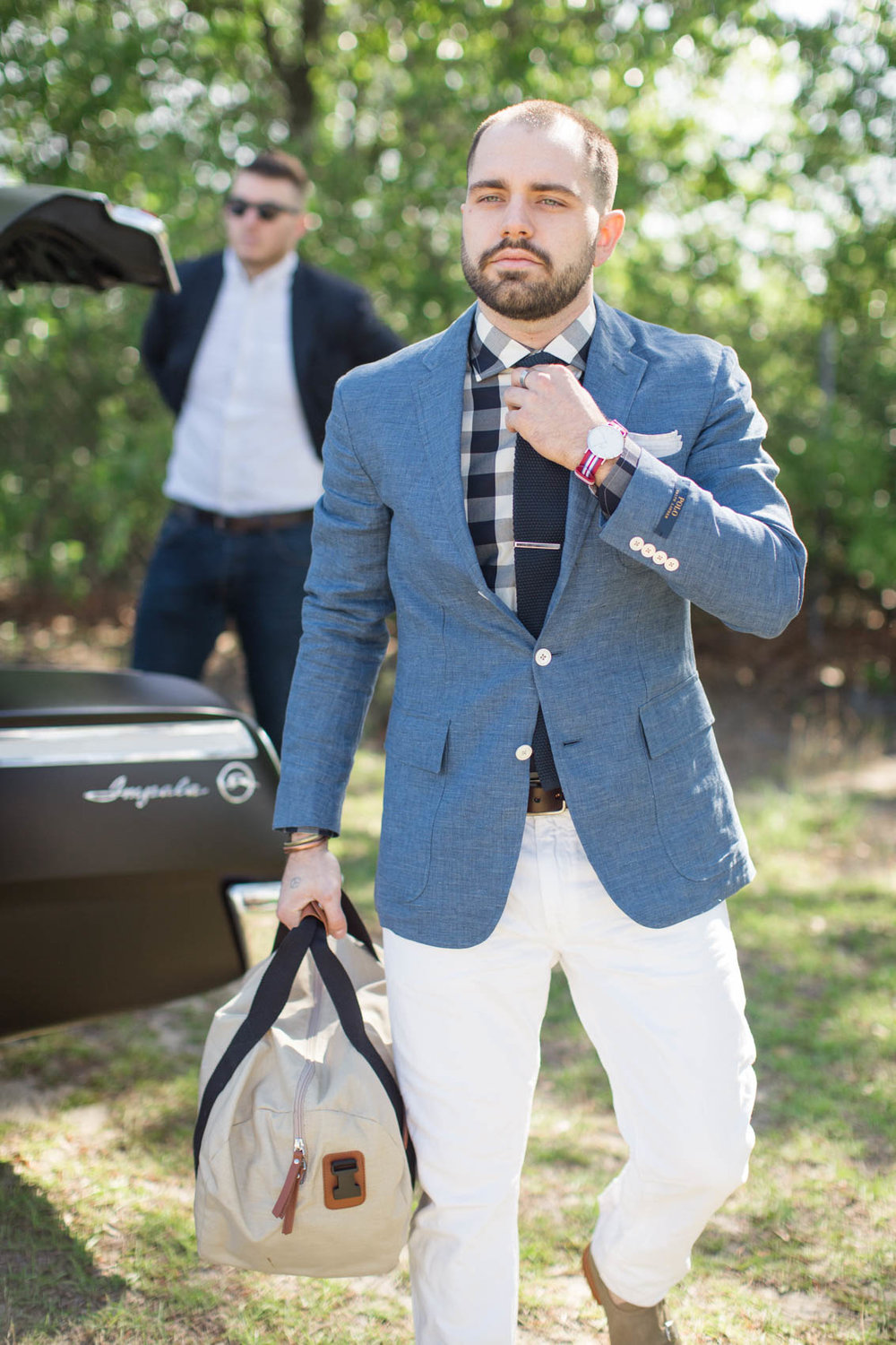 Male in gingham shirt and sport coat on weekend trip